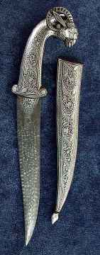 Rams head dagger with silver detail and Damascus steel blade