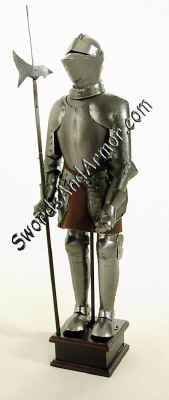 Miniature medieval knight in suit of armor holding halberd pole arm