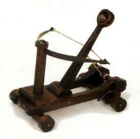 Miniature medieval catapult seige weapon