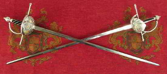 Renaisance rapier swords on tapestry background